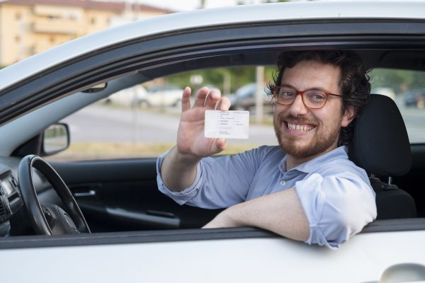 Driving school student with drivers license
